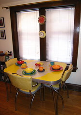 dining table w/ fiesta ware (astralbeing79) Tags: kitchen yellow table room plate bowl chrome dining dishes teacup fiestaware saucer butterdish formica saltandpeppershakers