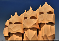 Casa Mil Chimneys (#122) (Christopher Chan) Tags: barcelona travel yellow canon geotagged spain europe unesco gaudi slideshow 1785mm casamil worldheritage lapedrera 1k 30d antonigaudi interestingness122 i500 geotagbarcelona abigfave redbubble geo:lat=41387917 geo:lon=2169919