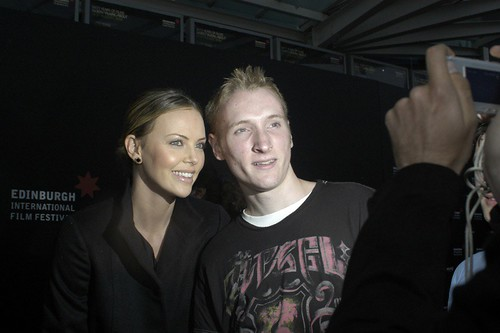 Charlize Theron with fan.jpg