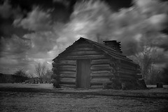 the log house (briphi) Tags: bw blur clouds dark landscape ir fineart eerie logcabin infrared loghouse longexposer