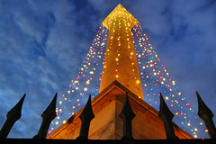 christmas at the monument (Idle Type) Tags: christmas xmas blue wallpaper sky clouds lights nikon holidays glow maryland 2006 baltimore lookatme d200 wallpapers washingtonmonument 1870mm mountvernon mtvernon christmas2006 nothdr nikonstunninggallery