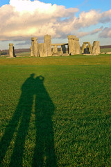 Our long December shadows with Stonehenge