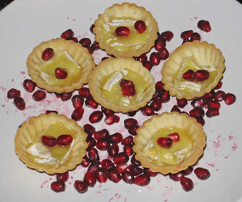 Warm Camembert tart with truffle honey and pomegranate seeds