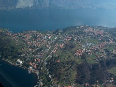 Bellagio (_ Night Flier _) Tags: above city travel blue sky italy panorama lake rooftop nature water airplane landscape town flying high view earth top aviation aerial h2o fromabove coastline bellagio lombardia cessna italians skyview lagodicomo lombardy birdeye aeronautic