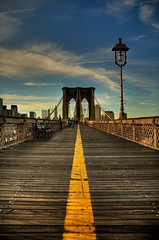 Walking Across the Brooklyn Bridge (New England Wedding Photographer Doug Levy http://) Tags: road nyc newyorkcity travel sunset sky urban newyork me topf25 museum brooklyn clouds digital vanishingpoint interestingness topf50 nikon flickr cityscape d70s bridges wideangle landmark nikond70s structure best views brooklynbridge saturation mostinteresting roads 500 popular score nikondigital platinum hdr highdynamicrange 47 100club urbanlandscape skyclouds mostviewed thisisamerica 2000views greatcolors douglevy 3000views cotcmostfavorited landscapeartist 100faves 1000v40f views2000 views3000 americanlandmarks tophdr bostonphotographer 123f50 picswithframes impressedbeauty flickrplatinum holidaysvacanzeurlaub wowiekazowie newenglandphotographer focuslegacy roadoftheworld douglaslevy newenglandlandscapephotographer bostonlandscapephotographer nikonlandscapeartist bostonfineartphotographer newenglandfineartphotographer