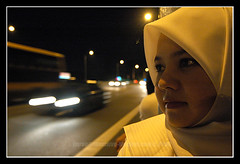Aiza - Watching the World Go By (axisofjustice) Tags: fireworks hijab aiza marinabay benjaminshearesbridge tokina1224mm newyearsday2007