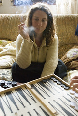 Yaeli plays Backgamon (Dror Miler) Tags: people woman play cigarette smoke backgammon yaeli  nikond80 sigma2470mmd128exdg