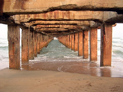Vanishing pier (Ravages) Tags: world life street city travel sea urban india beach home water modern river lights coast pier vanishingpoint flickrbadge asia hometown contemporary candid madras perspective streetphotography photojournalism coastal slice shore badge record metropolis moment chennai indianarchive tamil metropolitan journalism tamilnadu global bayofbengal indianness coastalcity nikonstunninggallery chennapattanam thalankuppam  visitindia visitchennai pattinam perspectivew4 lppoint chennaipattanam keezhkadal dwcffstreet
