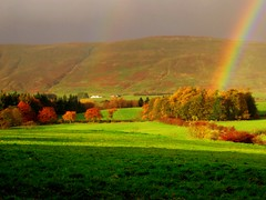 Oh look ,there is a rainbow ! (Nicolas Valentin) Tags: trees sky colour green nature scotland rainbow beautifull themoulinrouge specland abigfave lovenaturegroup impressedbeauty superaplus aplusphoto onenessplains triberainbow