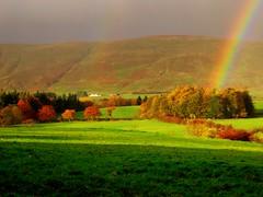 Oh look ,there is a rainbow ! (Nicolas Valentin) Tags: trees sky colour green nature rain scotland rainbow day beautifull themoulinrouge specland abigfave lovenaturegroup impressedbeauty onenessplains triberainbow
