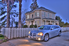 "Magnum in HDR ((Concepts by) Nicholas Daniel ""@tak"" Lopez) Tags: 2005 trees orange house color home fog photoshop fence silver high aluminum dynamic bright dusk wheels victorian headlights palm driveway dodge cs hemi remodel range rt hdr levels magnum tonal lightd photomatix photomatrix"