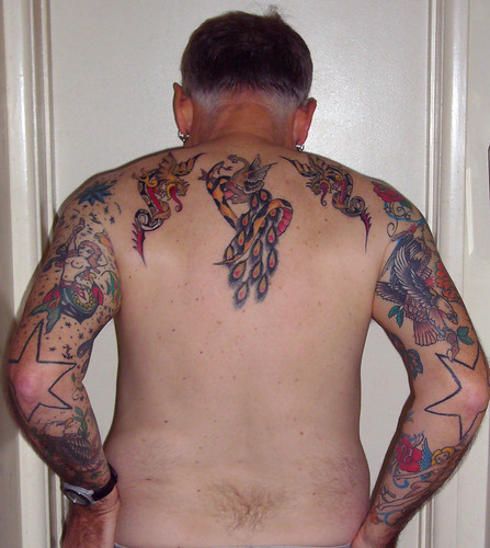 His tattooed arms are as often painted. Old School Tattoos - Back and Arms.