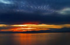 Ridgelines continued (Belltown) Tags: seattle sunset orange water silhouette lensbaby clouds 3g softfocus elliottbay