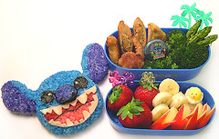 Stitch bento 02-23-07 (pkoceres) Tags: tree bunny chicken apple japan lunch strawberry stitch coconut sauce sesame egg shrimp mini broccoli banana disney palm chick hibiscus asparagus onigiri bento pick teriyaki quail quesadilla  eggroll  lilostitch icookedthis   charaben