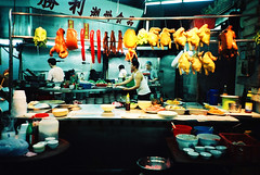 dilemma (* andrew) Tags: people food chicken film hongkong duck store lomo lca superia sausage bowl vegetable octopus fujifilm 100 fujicolor 32mm  suimey