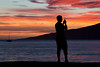 Enjoying A Lahaina Sunset (Edmonton Ken) Tags: maui hawaii lahaina ocean pacific sunset lanai sailboat boat orange purple blue yellow cell phone silhouette black