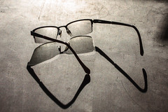 glass and light I (TheLittleMiss) Tags: light shadow contrast glass bright eyeglasses wood table reflection