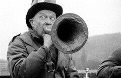 Horn Man (peterkelly) Tags: old bw musician music man film eyes prague trumpet jazz tophat czechrepublic busker horn charlesbridge bugle