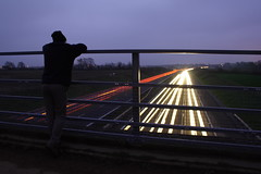 Watching the traffic (Matt Browne) Tags: longexposure bridge 350d driving motorway kitlens devon exeter sillouette lighttrails 1855mm m5 poltimore