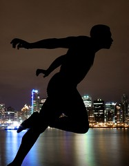 The Sprinter (A Sutanto) Tags: city sculpture canada reflection statue skyline night vancouver buildings bay bc britishcolumbia stanleypark silhoutte flickrplatinum