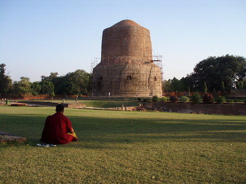 monk praying near Dhanekh-stupa