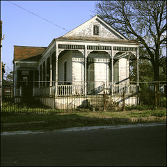 New Orleans 1984 (jeff lamb) Tags: architecture fence us louisiana neworleans historic uptown vernacular prc eastlake carrolton sideporch shotgunhouse sidegallery gableandwing noahsurvey