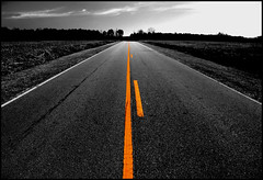 open road (JKnig) Tags: road bw orange color yellow photoshop pavement northcarolina openroad selectivecolor pselements pittcounty andeverything pittcountync aproposofnothing andshesright wellanattemptanyways igotacallfrommyfriendcateyesterday itwassofuckinggoodtohearhervoice ithinkiamgoingtotryandusethetermpolygonallassotoolinameetingatworktoday totallyoutofcontext lestyouthinkiamagraphicdesigner whichiamnot thoughivealwayswantedtobeone asmyfriendstephaniewhoisagraphicdesignerwillconfirm sheandiusedtoworktogether andeverytimeidgiveherfeedbackonasitedesignshedsayeverybodywantstobeadesigner imawebprojectmanagersee