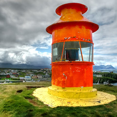 Stykkishlmur lighthouse (Lumatic) Tags: ocean red sky orange lighthouse tower nature topf25 sign yellow topv111 clouds digital landscape photography coast photo iceland topv555 topv333 flickr wind photos harbour picture 100v10f atlantic online nautical scandinavia signal beacon digitalphoto navigation hdr digitalphotos stykkishlmur lotse nautic 200v20f niceland navigationallight photosonline photoonline lumatic