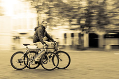 Just another panning shot... (manganite) Tags: street people men topf25 bike bicycle sepia digital speed germany geotagged interestingness cool movement topf50 nikon europe bonn tl squares candid streetscene bicycles explore german d200 nikkor dslr panning mnsterplatz northrhinewestphalia interestingness38 i500 18200mmf3556 utatafeature manganite nikonstunninggallery 25faves ipernity challengeyou challengeyouwinner abigfave impressedbeauty flickrjobdiff goldenphotographer diamondclassphotographer flickrdiamond geo:lat=50733666 geo:lon=7099683 thegoldenmermaid date:year=2006 date:month=october date:day=15