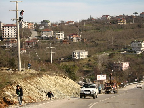 The guys on the powerpole have no safetly line (safe work place near Akcakoca, Black Sea caost of Turkey)