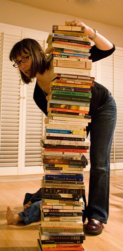 Woman with stacked books