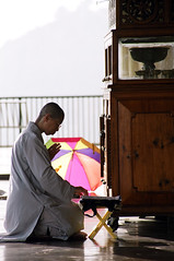 Budhist Prayer (elbud) Tags: india film colors umbrella canon eos prayer praying monk lama dharamshala dalai budhist ganj mcleod 3000n platinumheartaward