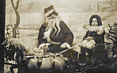 Evil Santa circa 1918 (scotcrow) Tags: santa christmas old family portrait cute girl drunk fur coat evil screen pony sled 1918 clause