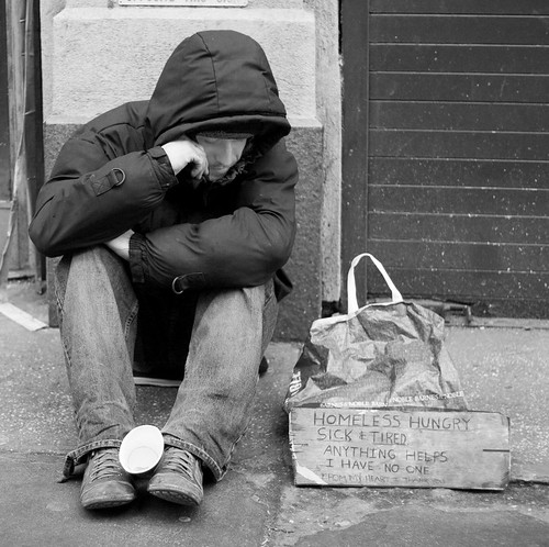 Homeless Person With Cup