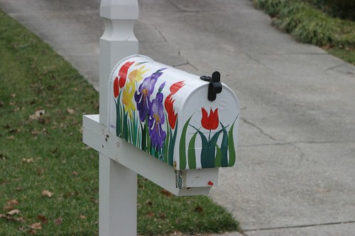rural route postal mailbox with tulips and flower designs painted on the side