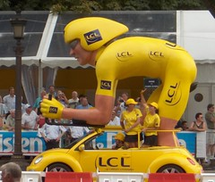 Tour De France 2 (Crop) (Joe Shlabotnik) Tags: paris volkswagen bicycling beetle 2006 biking blogged tourdefrance champselyses myfave yellowjersey yellowcar faved lcl crditlyonnais july2006 explored snipshot brokentimestamp myphotoseverywhere heylookatthis
