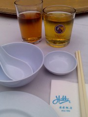Beer served in a half-glass as well as Chinese tea served in a glass vessel