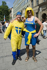 PT061710 (Paul Thompson2007) Tags: world travel vacation people sunlight white holiday game hot men travelling chicken tourism cup face smiling sport yellow del germany munich fun drag happy deutschland marketing fan cow costume football support breasts funny warm paint colours dress bright market fifa joke flag soccer contest joy group humor kopp competition pride 2006 tribal humour du victory cash celebration identity journey wig exploitation fancy passion fishnets leisure munchen recreation worldcup amusing mundial tribe monde captive patriotism globalisation success tyskland defeat allemagne elation footy coupe futebol germania supporters alemanha false xícara svensk global association nationalism fußball pastime belonging fotboll headwear mondo headgear compete fusball coppa värld solfjäder