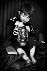 Bones and the lamp ({amanda}) Tags: boy lamp kid toddler child mykid 85mm naturallight 23months firewood woodpile oillamp amandakeeysphotography bonesshirt