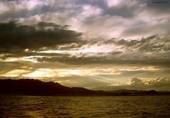 La luz abrindose paso... (Carmen Lario) Tags: light sunset sea sky luz clouds mar cielo nubes puestadesol sevenseas carmenlario abigfave