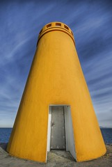The Lighthouse (Stuck in Customs) Tags: world ocean travel light sky lighthouse cold art beautiful yellow clouds boats photography photo iceland nikon bravo colorful pretty photographer dynamic vibrant gorgeous d2x dream fresh divine professional adventure international photograph stunning getty fjord top100 charming foreign fabulous technique hdr tutorial trey gettyimages 2007 eyjafjrur artisitic engaging highquality travelphotography ratcliff cury d2xs hdrtutorial stuckincustoms imagekind treyratcliff hlmabergsviti stuckincustomsgooglescreensaver representedbygetty eyjafjardarsysla spicescolor mistressofthespices
