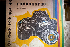 Timbuktu Photography (Swiatoslaw Wojtkowiak) Tags: africa camera travel art shop wall emblem advertising poster photo nikon photographer grafitti ad exotic journey commercial westafrica remote mali timbuktu publicity distant  timbuctu  tomboctou  timbuctou timbuktoo