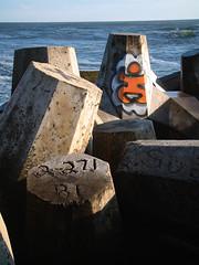 Manasquan inlet (Night Owl City) Tags: ocean concrete graffiti newjersey jetty nj atlantic seawall armor inlet monmouthcounty breakwater manasquan revetment