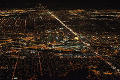 Arriving at Night (dbcnwa) Tags: usa night plane canon airplane lights evening flying moving lowlight colorado downtown aircraft aviation denver aerial citylights airborne downtowndenver iso6400 canonef24105mmf4lisusm canoneos5dmarkii