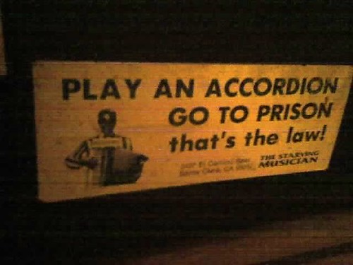 play an accordion