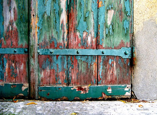 Door in decay with decomposed varnish layers