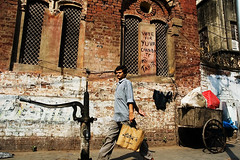 Water-pump, cart and a shopping man