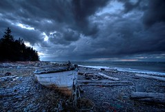 Emotion (iJohn) Tags: ocean old sea abandoned beach rock clouds dark boat bravo waves quality wave driftwood shore angry derelict stormclouds beachrock abigfave impressedbeauty