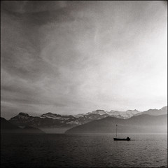 (maz hewitt) Tags: lake mountains backlight landscape switzerland boat luzern bronica grainisgood sqa xtol weggis delta400 xtol11 mazhewitt camera:name=bronicasqa
