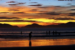 Golden Sand, Multicolored Sky (Ricardo Carreon) Tags: sunset people sun praia beach brasil playa feed guaruja silouettes 1on1colorful